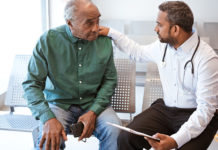 Male Doctor Consulting elderly Male Patient.