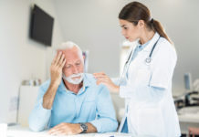 Worried senior man on a visit to supportive doctor.